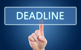 Hand pressing Deadline button on interface with blue background.