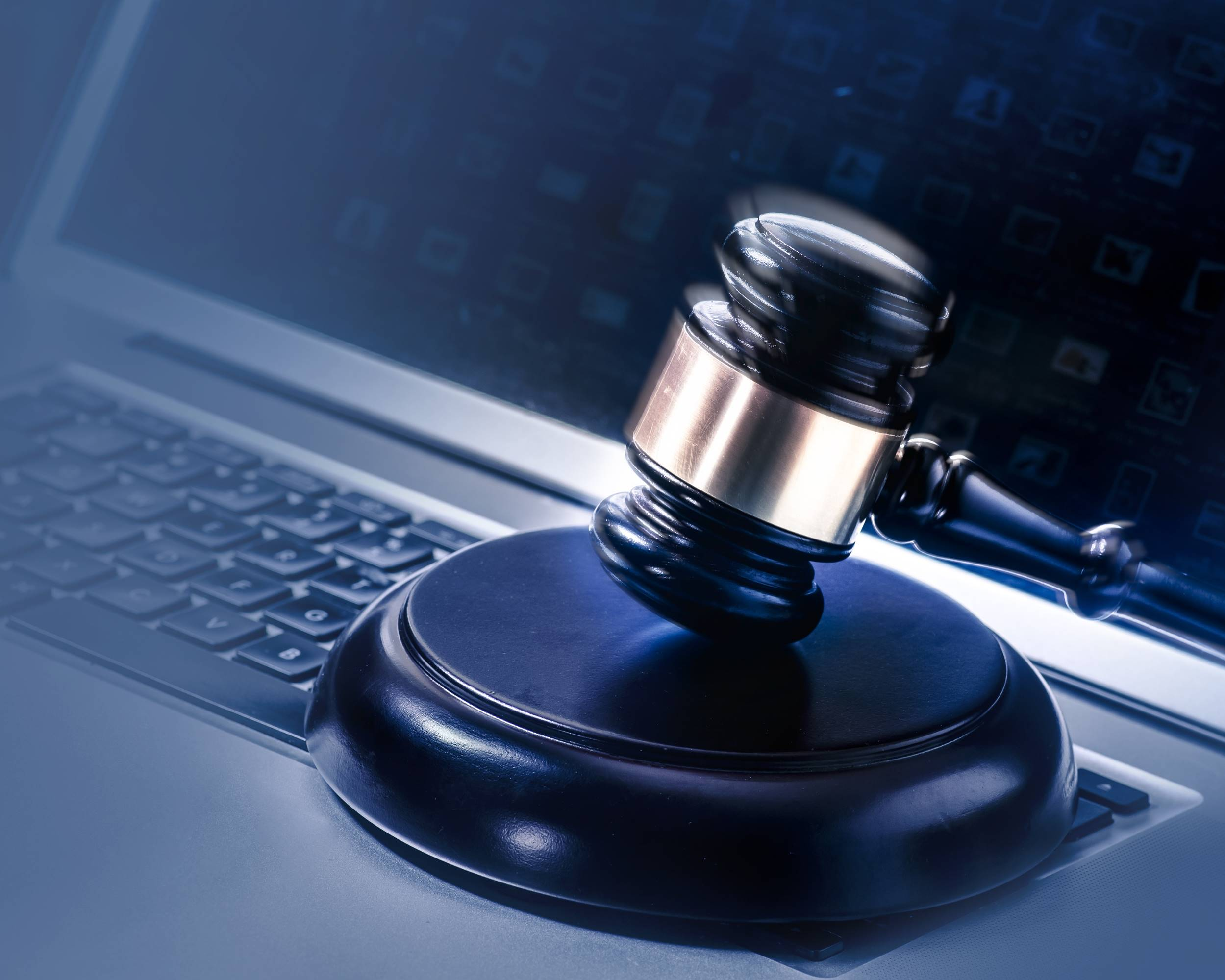 Gavel on a computer legal law